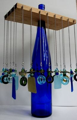 Necklace Hanger...Find a glass bottle you would like to use with a long neck; cut a hole in the center of a piece of plywood; add screw-in h...