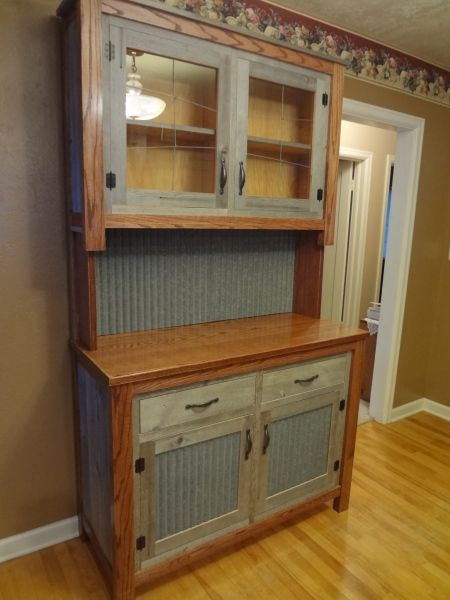 I made this with Recycled barn wood and tin from an old homestead ...