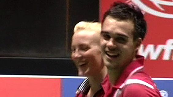Chris Adcock and Imogen Bankier have progressed to the quarter-finals of the Badminton World Championships by claiming their second major scalp.