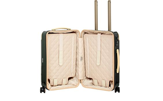 Rimowa Carry-On: Not only is this Rimowa carry-on a stunner, but its utilitarian inside includes a quilted tech fabric with two removable dividers to maximize organization.