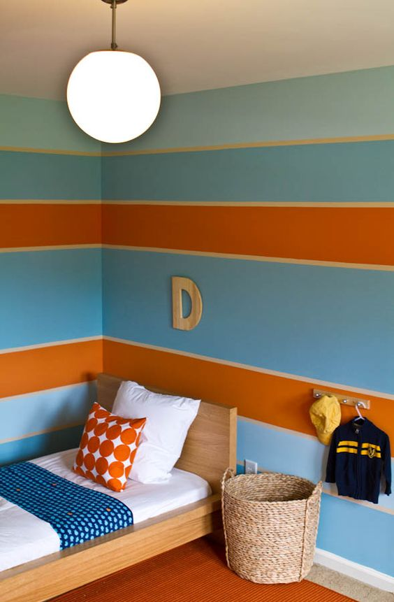 This big boy room is the perfect mix of blue and orange. {Love the stripes!} #bigboyroom #stripes:
