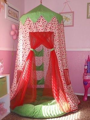 DIY hoola hoop fort. Could be a reading tent, or a secret hideaway, or a sleeping nook..i'd take a nap there now..