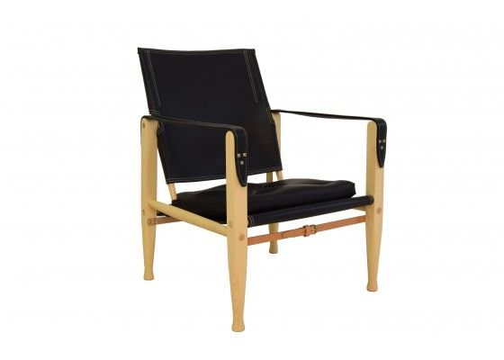 This Safari Chair was designed in 1933 by Kaare Klint and manufactured in Copenhagen from Rud Rasmussen. He is covered with black leather and has an ash wood frame. In very good vintage condition.
