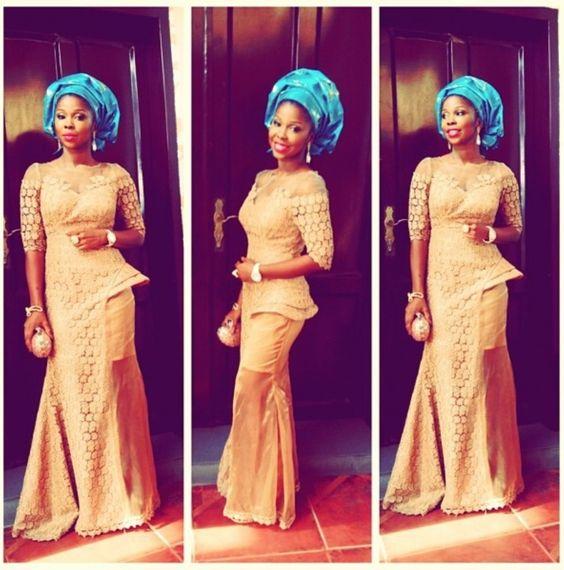 Orange lace dress with Blue Gele. Nigerian wedding.