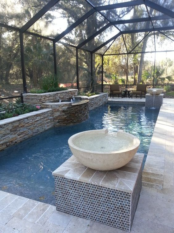 Traditional Swimming Pool with Skylight, Pool with hot tub, Raised beds, exterior stone floors, Indoor pool