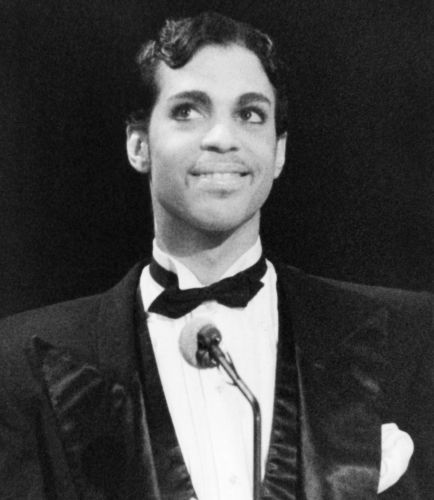 Singing star Prince is all smiles as he addresses the audience at the American Music Awards, Jan. 27, 1986 in Los Angeles. He was up for several awards but did not place, but did present the award in the Pop-Rock Category for favorite single to Huey Lewis for his 'Power of Love,' hit. (AP Photo/Nick Ut)                                     via @AOL_Lifestyle Read more: http://www.aol.com/article/2016/05/02/man-who-claims-hes-princes-son-wants-a-dna-test/21369115/?a_dgi=aol...