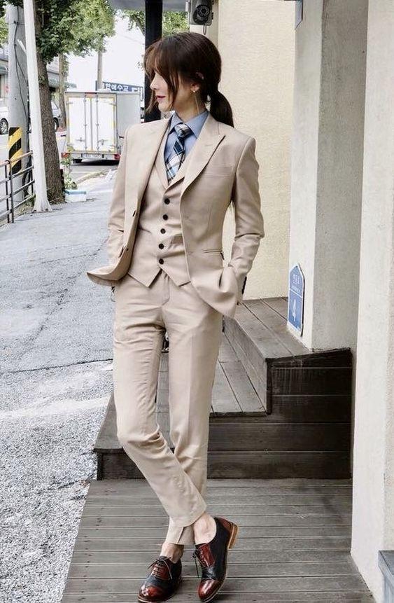 Woman looking very dapper in men's suit.