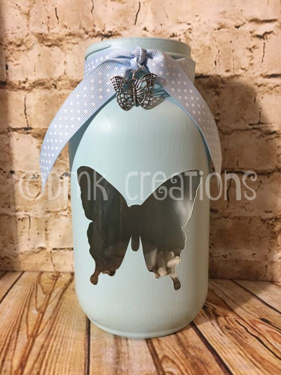 Butterfly mason jar tea light candle holder 7 inches tall, 32 oz painted mason jar. (quart size) Color in photos is denim blue, purple, light brown and light blue. You can choose any color. We have a variety of colors to choose from. Pick your color from drop down menu at checkout.