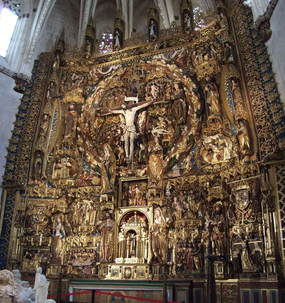 Retablo mayor de la Cartuja de Miraflores (Burgos, España). En el medallón central, Dios Padre y el Espíritu Santo (ambos con forma humana) sostienen los extremos del travesaño de la cruz