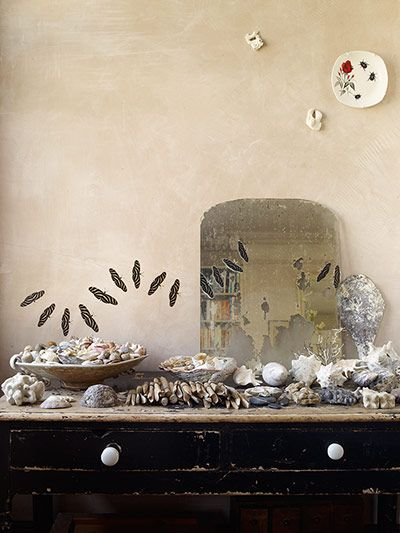 homes - lou rota: part of chest of drawers with seashells and other items against beige wall  from guardian - homes