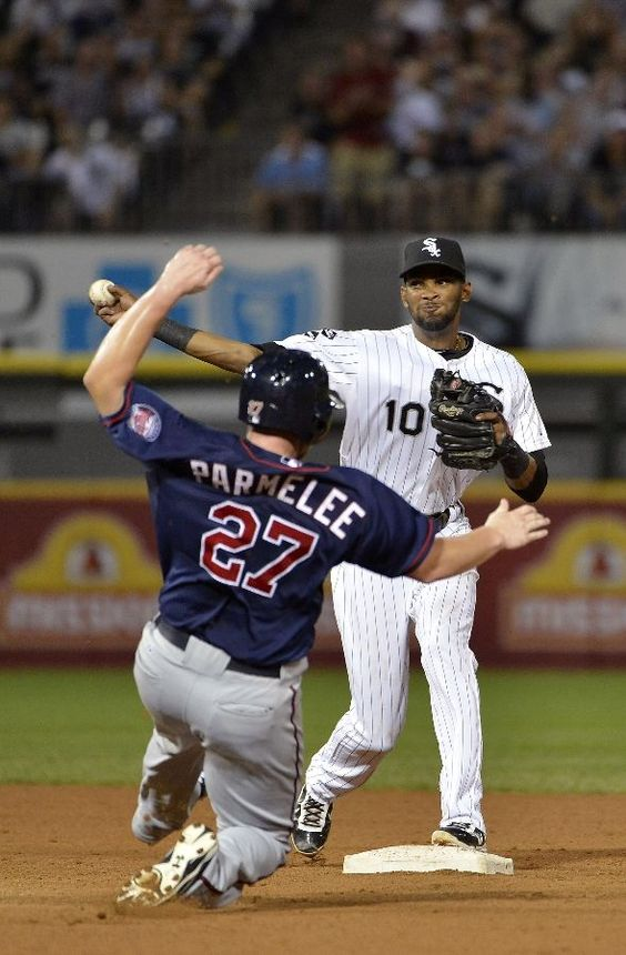 CHICAGO, IL - SEPTEMBER 3: Shortstop Alexei Ramirez #10 of the Chicago White Sox (R) turns a double play as Chris Parmelee #27 of the Minnesota Twins slides into second base on a ground ball hit by Alexi Casilla #12 during the ninth inning at U.S. Cellular Field on September 3, 2012 in Chicago, Illinois. The White Sox defeated the Twins 4-2. (Photo by Brian Kersey/Getty Images)