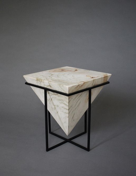The Gravity Series consists of 2 low and 2 high side tables and a long coffee table. The tables explore the relationship between simple forms and powerful forces, each relaying on its own weight and shape to allow it to function. The side tables are each cut from a single log of camphor laurel timber which is considered a week in Australia. The solid blocks are finished raw and suspended into steel frames and are held in place by their own weight.