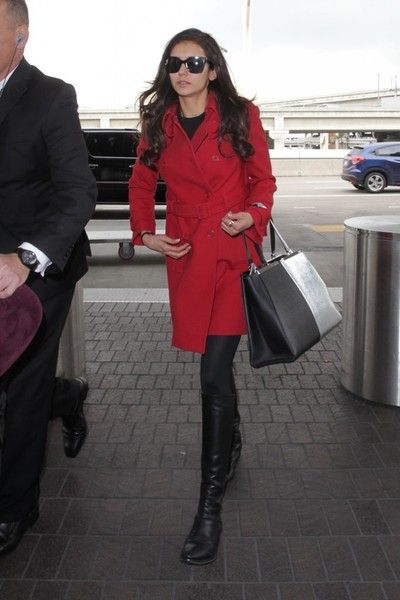 Nina Dobrev is spotted departing from LAX on January 9, 2017. The 'Vampire Diaries' actress was looking stylish in red and black. ***NO FRANCE, NO GERMANY, NO LATIN AMERICA, NO SPAIN, NO PORTUGAL***