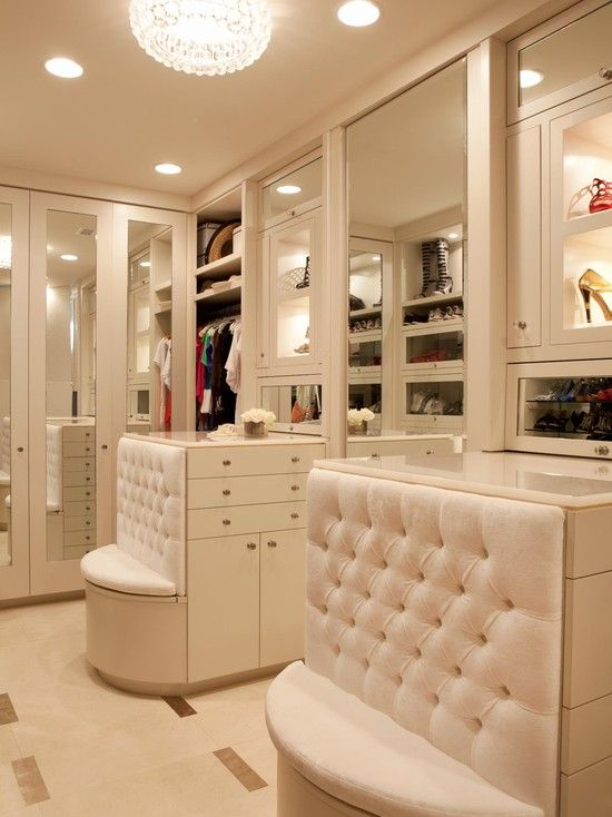 Walk-in closet with a mini sofa at the end if the closet islands #white #closet #storage #organization #allenrothCloset #allenAndRothCloset #closetShelves