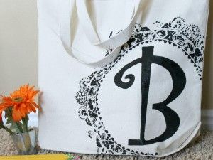Monogram tote bag, using a doily and some fabric paint.  So cute!