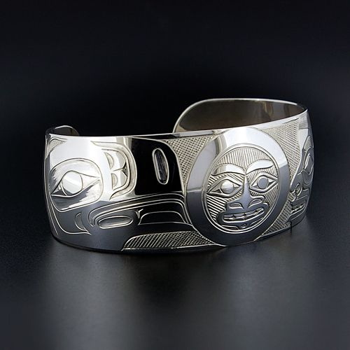 """Sterling Silver Bracelet with Raven, Moon and Human by Haisla Artist Derek Wilson. 1"""" x 6"""", $1000.00 CAD. Available at Lattimergallery.com."""
