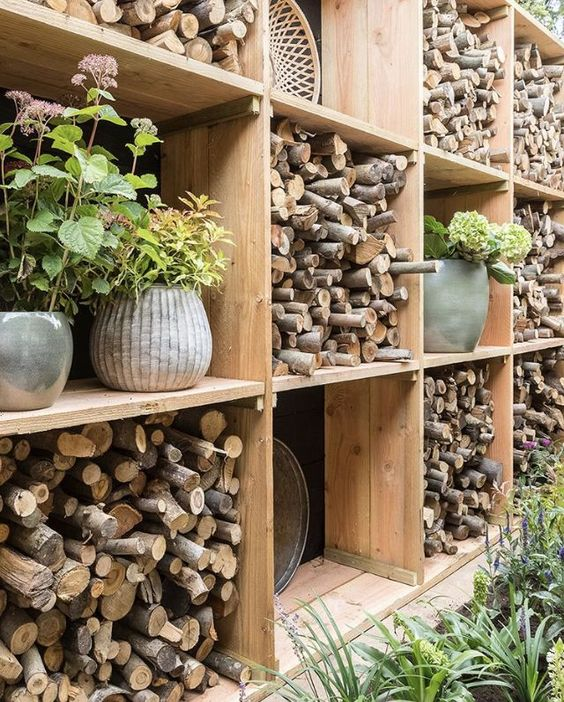 outdoor shelving for a firewood storage #fireWoodStorage #firewoodrack #firewood #firewoodideas #organization #wallStorage