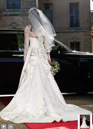 Kate Middleton..I have never seen this pic before! It seems to be Kate waiting to get into th car that would take her to the wedding! Beautiful moment!: