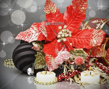 #Poinsettia flower & black #Christmas ornament over silver background #StockImage OD21232746