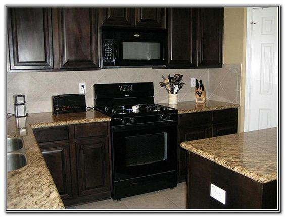 Dark wood cabinets with black appliances odguinz home for Kitchen cabinets with black appliances