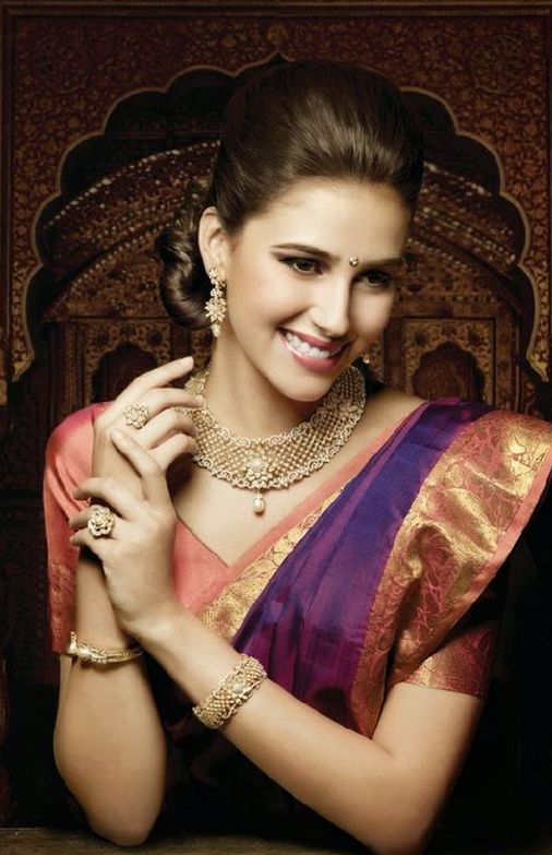 South Indian bride. Temple jewelry. Jhumkis.Pink and purple silk kanchipuram sari.Braid with fresh jasmine flowers. Tamil bride. Telugu bride. Kannada bride. Hindu bride. Malayalee bride.Kerala bride.South Indian wedding