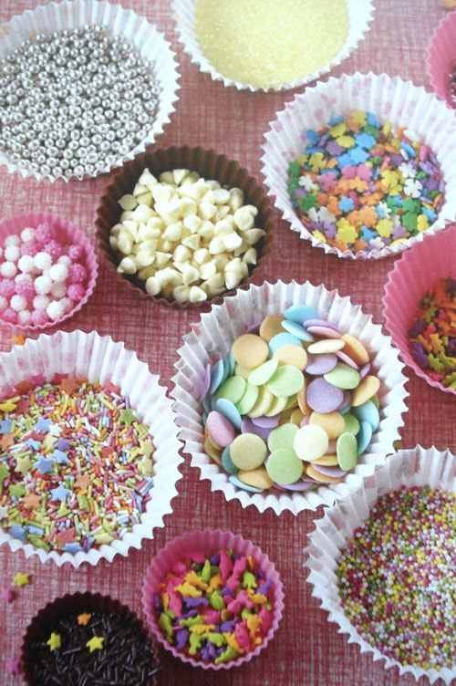cupcake decorating party sprinkle set up in cupcake liners