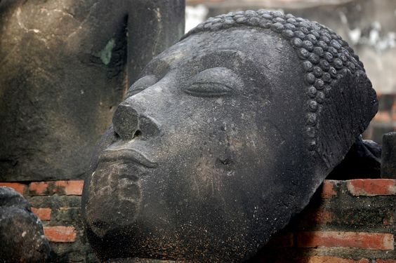 Napping Buddha head, Wat Ratchaburana, Ayutthaya, Thailand - Although the one wrapped in tree roots might be more famous, I think this is the better Buddha head.