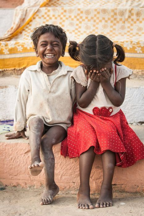 No information re: where these children are from--they just look like children from anywhere, shy or laughing.