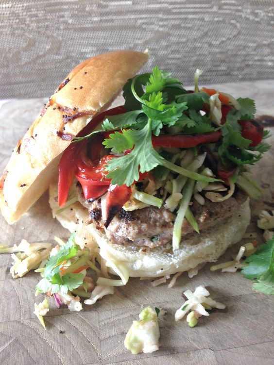 Thai-inspired turkey burgers topped with roasted red peppers, Asian slaw and refreshing cilantro. This hunk of burning love is a complete flavor party.