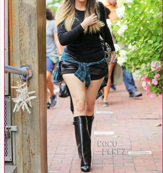This is the boot of my dreams!!! Khloe K makes them look so damn cheap.     Givenchy fold over wedge boot