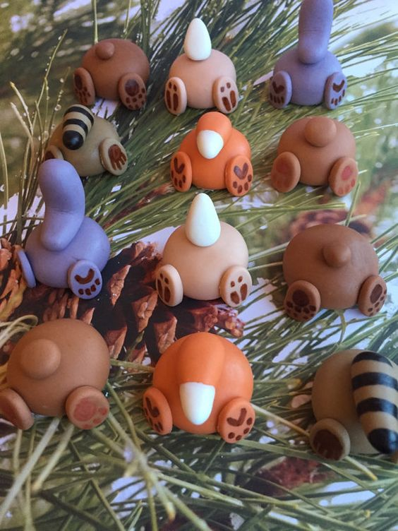 Set of 12 fondant woodland animal butts. About 1.5 inches. Perfect for the tops of cupcakes! 2 squirrels 2 foxes 2 bears 2 bunnies 2 raccoons 2