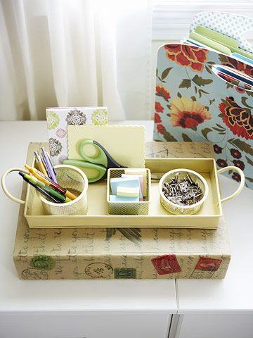 A repainted tray and metal cups neatly contain binder clips, sticky notes, and other desktop essentials.