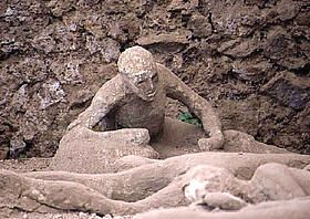 Man facing death in half upright position in ancient Pompeii.