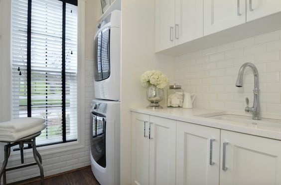 Amazing Laundry Room With Ivory Cabinets Paired With