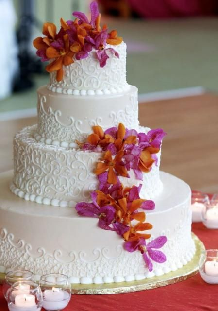4 Tier Light Pink Round Wedding Cake With Fresh Purple And Orange Flowers JPG