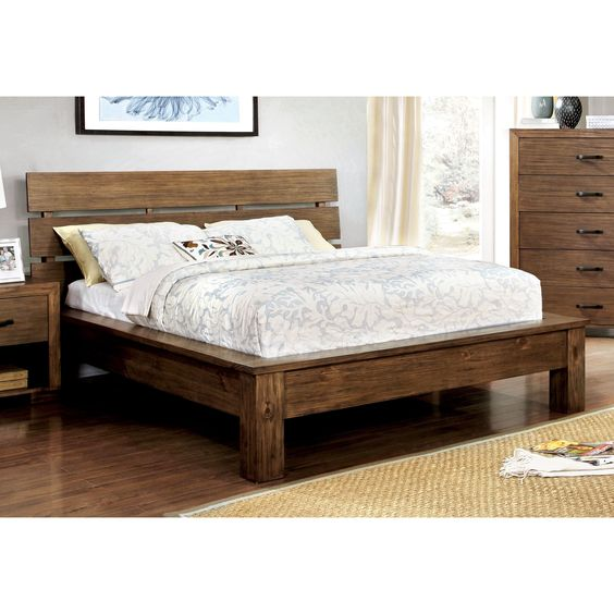 Capitalize on your love for the outdoors and bring some rustic elements into the bedroom. The plank style headboard mimics benches while the boxed platform structure adds height for necessary comfort.