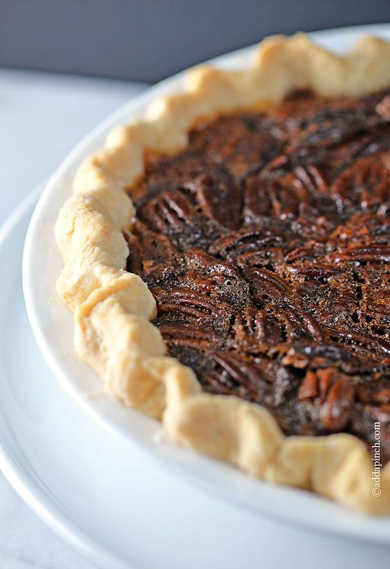 Pecan pie is a classic dessert that everyone loves. Get this family favorite pecan pie recipe that you'll turn to time and again. // addapinch.com