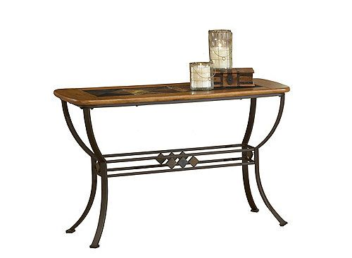 A mix of materials, textures and colors gives the Lakeview slate sofa table its universal appeal. Copper-brown metal, medium-oak wood and colorful slate combine in a dynamic design to add a unique accent to your living space.
