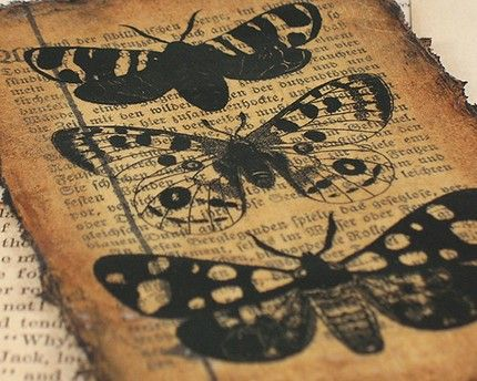 recycled book page art;  looks like tea wash with ink stamp