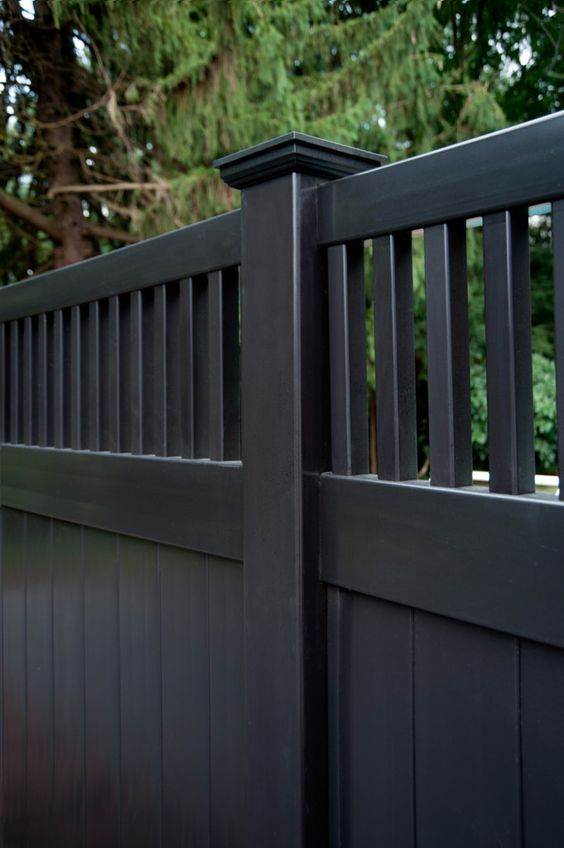 Illusions Black vinyl PVC privacy fencing panels will fill out your dream backyard. The shown style is the V3701-6. It's a 6' high privacy fencing panel shown in Grand Illusions Color Spectrum black. It also has a framed topper. Very cool looking fence. Good around pools as well.
