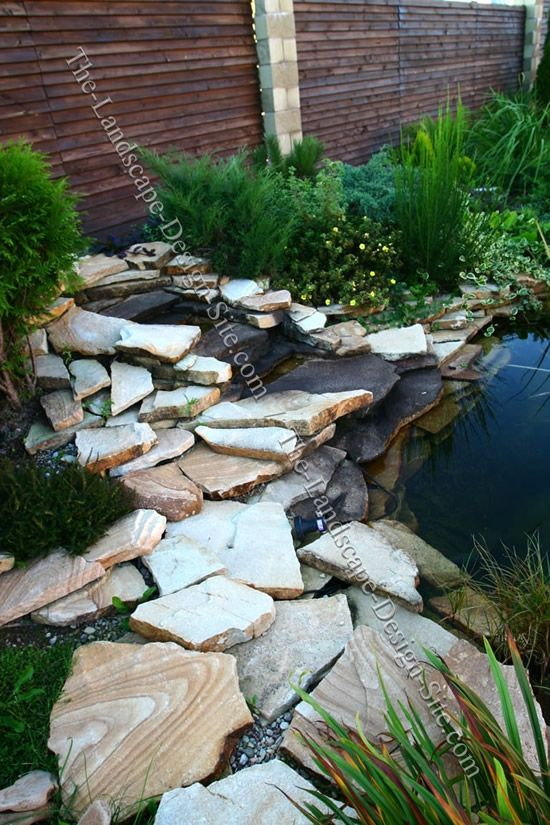 Backyard pond with waterfall photos garden pond with for Fish pond cover ideas