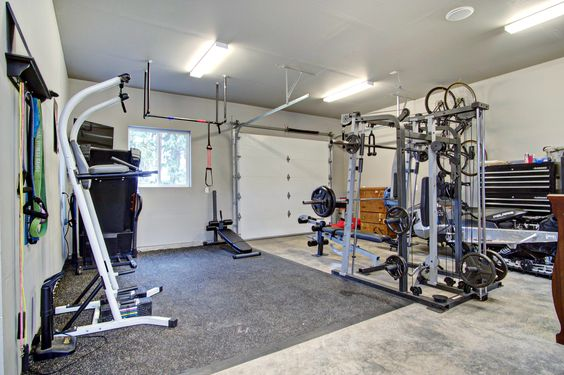 Add a home gym to your garage or tandem garage. DIY pull up bar, gym mat, window Plus roll up garage door for fresh air. #gnwhomes #curtbartkowskiphotos