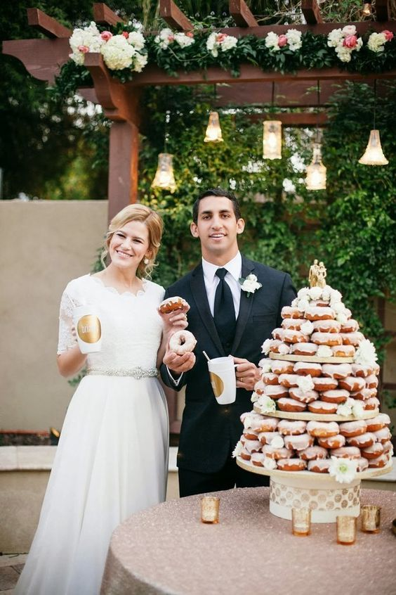 This drizzled tower of donuts as a wedding cake looks amazing