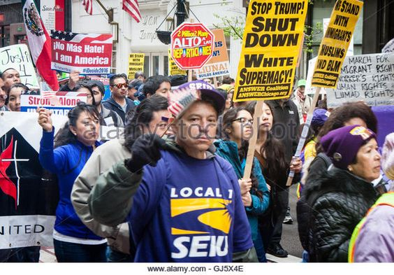 Hundreds of marchers unite on May Day in Chicago to protest Donald Trump's anti…