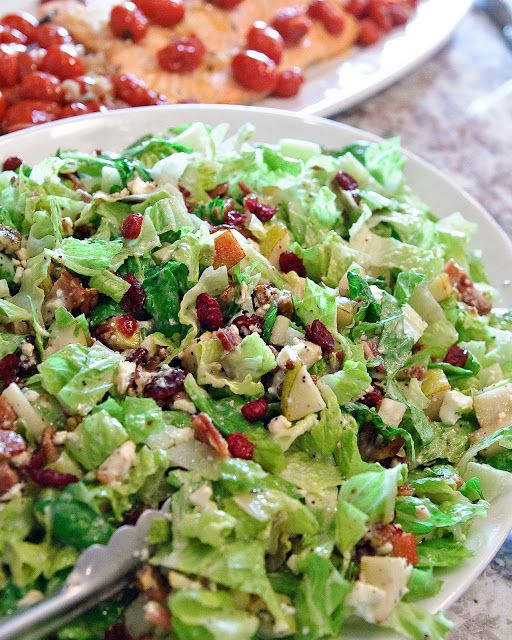 Autumn Chopped Salad  *romaine lettuce  *2 pears, chopped  *1 cup dried cranberries  *1 cup chopped, roasted pecans  *8 slices bacon, crisp-cooked and crumbled  *6 oz. feta cheese, crumbled  *Poppy seed Dressing   *Balsamic Vinaigrette