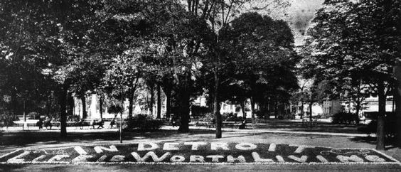 """A floral design in a flower bed of Grand Circus Park once read """"In Detroit life is worth living."""" (The Detroit News)"""