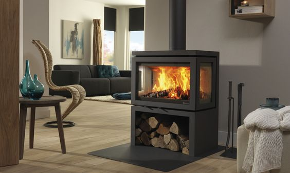 The Vidar Triple from DG Fires features heat reflective glass in it's 3 large windows to help produce a very high efficiency rating of 88%. The Triple has a large storage area underneath it for your firewood. Rated at 6 - 9 kWs.