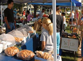 Pic of the Day, Tuesday Sept. 18. Visitors peruse the Farmer's and Artisans market.