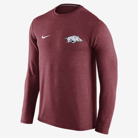 REPRESENT YOUR TEAM The long-sleeve Nike College Dri-FIT Touch (Arkansas) Men's Training Shirt helps keep you comfortable and moving freely during your workout with lightweight Dri-FIT fabric and underarm insets. Benefits Dri-FIT fabric helps keep you dry and comfortable Underarm insets for wider range of motion Flat seams feel smooth against your skin Product Details Crew neck with interior taping Fabric: Dri-FIT 100% polyester Machine wash Imported