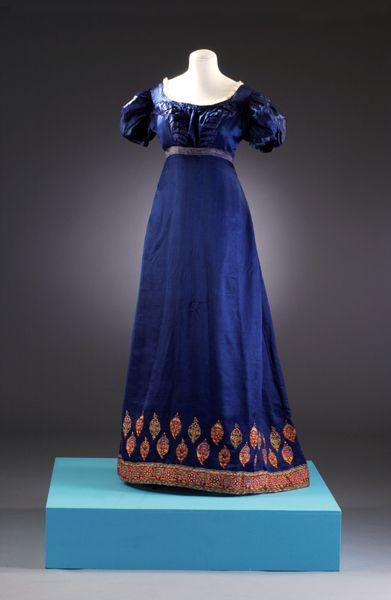 Image: Long dark blue dress with patterned hem line (picture: Mandy Reynolds) - museum of costume, Bath